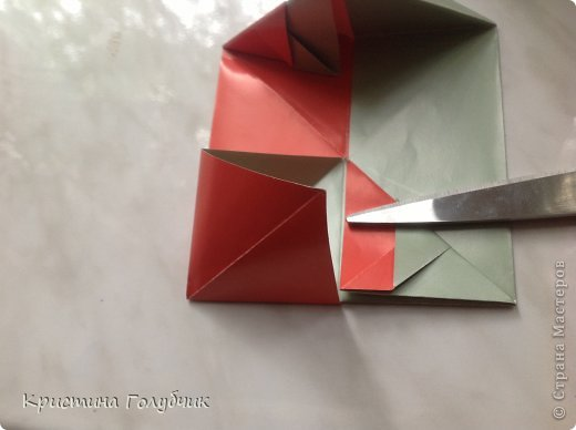 Привет! Хотите сделать такое легкое украшение? Тогда вы по адресу! Источник: http://planetaorigami.ru/2011/09/simvol-in-yan-iz-bumagi-po-sxeme-sy-chen/ фото 17