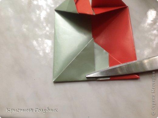 Привет! Хотите сделать такое легкое украшение? Тогда вы по адресу! Источник: http://planetaorigami.ru/2011/09/simvol-in-yan-iz-bumagi-po-sxeme-sy-chen/ фото 24