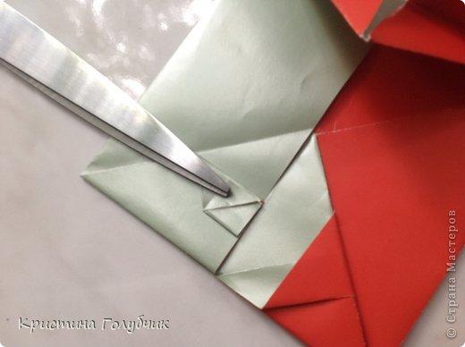 Привет! Хотите сделать такое легкое украшение? Тогда вы по адресу! Источник: http://planetaorigami.ru/2011/09/simvol-in-yan-iz-bumagi-po-sxeme-sy-chen/ фото 29
