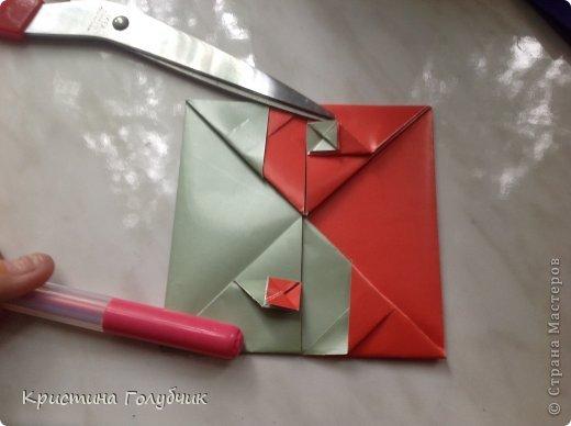 Привет! Хотите сделать такое легкое украшение? Тогда вы по адресу! Источник: http://planetaorigami.ru/2011/09/simvol-in-yan-iz-bumagi-po-sxeme-sy-chen/ фото 31