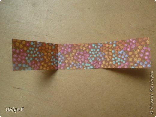 """Снова здравствуйте!  Следующая модель из ленточно-цветочной серии Индира. Она получилась самой аккуратной и кругленькой.   Name: Indira collection """"Ribbon Flowers"""" Designer: Uniya Filonova Units: 30 Paper: 2,9 * 15 sm  Final height: ~ 8,5 sm Joint: no glue фото 2"""