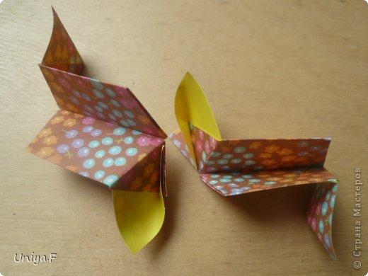 """Снова здравствуйте!  Следующая модель из ленточно-цветочной серии Индира. Она получилась самой аккуратной и кругленькой.   Name: Indira collection """"Ribbon Flowers"""" Designer: Uniya Filonova Units: 30 Paper: 2,9 * 15 sm  Final height: ~ 8,5 sm Joint: no glue фото 16"""