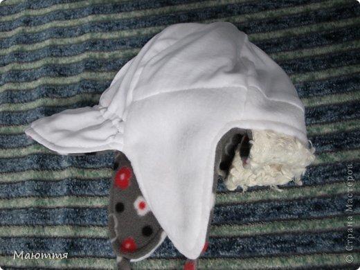 Решила я испробовать выкройку шапки-ушанки. Получилось маловато, но я добавила трикотаж на лоб и затылок, и вышло еще лучше, чем задумывалось))) фото 13