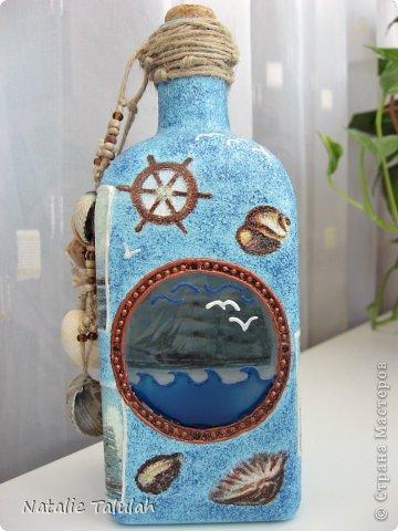 Смастерила еще одну морскую бутыль.  Имеется иллюминатор с видом на бескрайнее море, а по морю плывет корабль :) фото 1