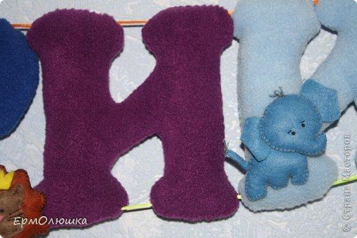 Сшила своему мальчику вот такую растяжку. Буквы из флиса, звери из фетра. фото 8
