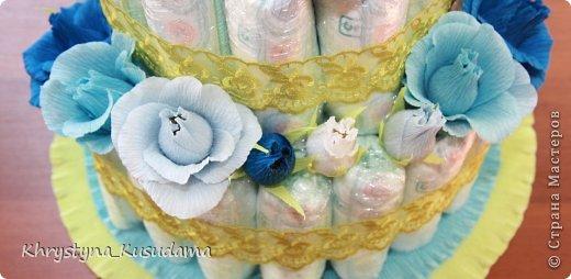 торт з памперсами и конфетами. 69 памперсов, 39 конфет АВК Трюфель фиолетовый фото 2