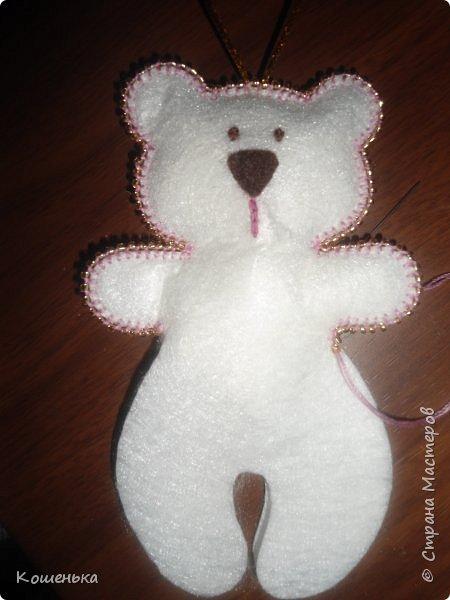 Добрый вечер, дорогие мастерицы! Предлагаю Вашему вниманию обещанный мастер-класс по изготовлению медвежонка из фетра. фото 15