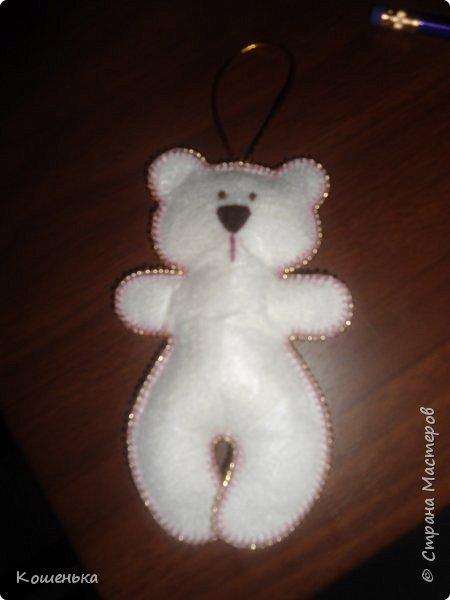 Добрый вечер, дорогие мастерицы! Предлагаю Вашему вниманию обещанный мастер-класс по изготовлению медвежонка из фетра. фото 17