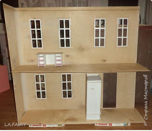Такой кукольный домик сделал наш папа (из фанеры 6 мм.). Это одно из первых фото. фото 20