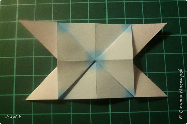 """Эта звездочка из 5 модулей смотрится очень лучисто и рельефно. Имеет односторонний эффект, хороша из градиентной бумаги. Подойдет для кусудам. Как снежинку можно сделать из 6 модулей.  Name: Toccata star  Collection origami stars """"Philharmonia"""" Designer: Uniya Filonova   Units: 5  Paper: 7,5 x 7,5 cm   Final diameter: 9 cm  Joint: no glue  фото 7"""