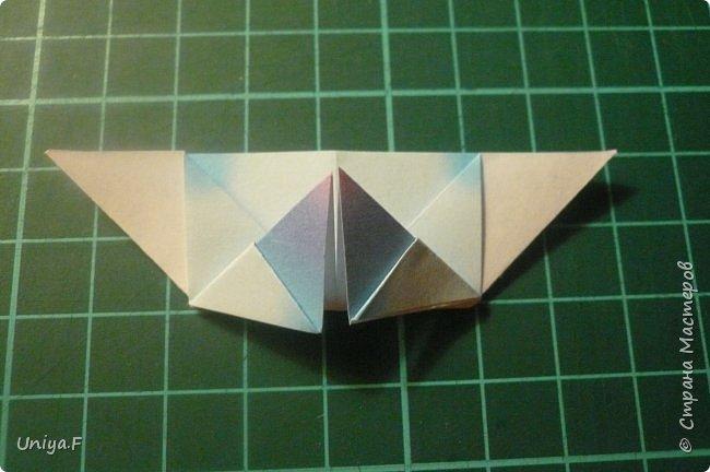 """Эта звездочка из 5 модулей смотрится очень лучисто и рельефно. Имеет односторонний эффект, хороша из градиентной бумаги. Подойдет для кусудам. Как снежинку можно сделать из 6 модулей.  Name: Toccata star  Collection origami stars """"Philharmonia"""" Designer: Uniya Filonova   Units: 5  Paper: 7,5 x 7,5 cm   Final diameter: 9 cm  Joint: no glue  фото 11"""
