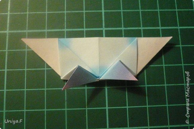 """Эта звездочка из 5 модулей смотрится очень лучисто и рельефно. Имеет односторонний эффект, хороша из градиентной бумаги. Подойдет для кусудам. Как снежинку можно сделать из 6 модулей.  Name: Toccata star  Collection origami stars """"Philharmonia"""" Designer: Uniya Filonova   Units: 5  Paper: 7,5 x 7,5 cm   Final diameter: 9 cm  Joint: no glue  фото 12"""