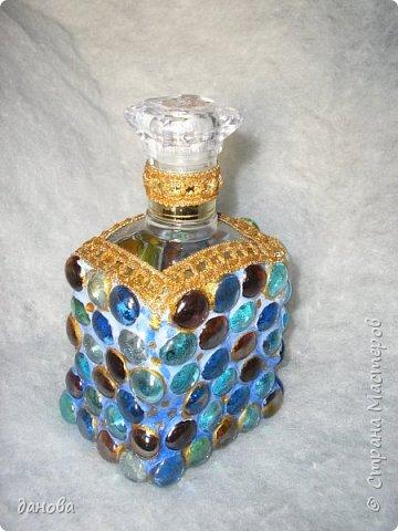 """Иногда из бросового материала, бутылочка становится предметом оформления интерьера. Бутылка, клей типа """"Титан - солит"""", капроновая верёвка, стразы, бусинки и вот что вышло. фото 5"""