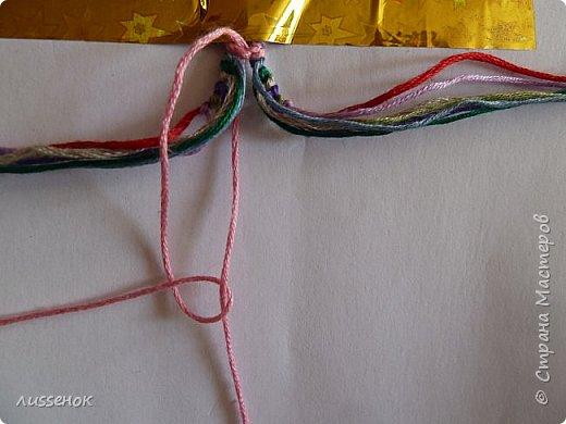 Хорошего всем настроения жители Страны Мастеров! Сегодня я хочу рассказать о плетении классической фенечки - конфетки из 16 нитей. фото 12