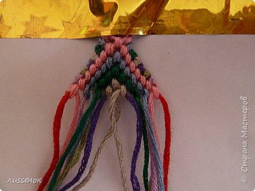 Хорошего всем настроения жители Страны Мастеров! Сегодня я хочу рассказать о плетении классической фенечки - конфетки из 16 нитей. фото 17