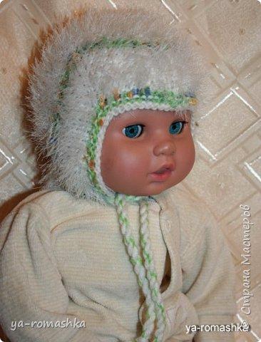 Всем доброго времени суток! В интернете я нашла схему по вязанию чудесной шапочки для новорожденного. Используя схему я связала свою шапочку для внучки, но немного иначе. (примерка на куклу).  фото 2