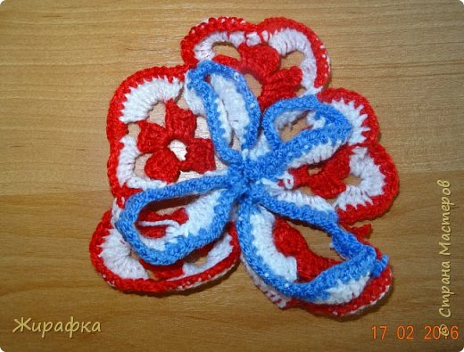 Вяжем цветок-интригу... фото 21