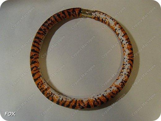 Вот такой тигр! Очень долго вынашивала этот жгут! В диаметре 28 бисеринкой, длиной 45 см, нитки 70лл, крючок 0,8, весь бисер японский 15/0, застёжек магнитная. фото 1