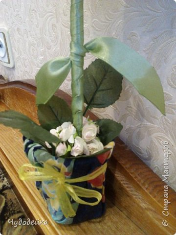 Вот такой цветочек у меня получился в этот раз, делала уже подобный, но без личика. МК цветка http://stranamasterov.ru/node/517075?c=favorite фото 4