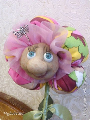 Вот такой цветочек у меня получился в этот раз, делала уже подобный, но без личика. МК цветка http://stranamasterov.ru/node/517075?c=favorite фото 1