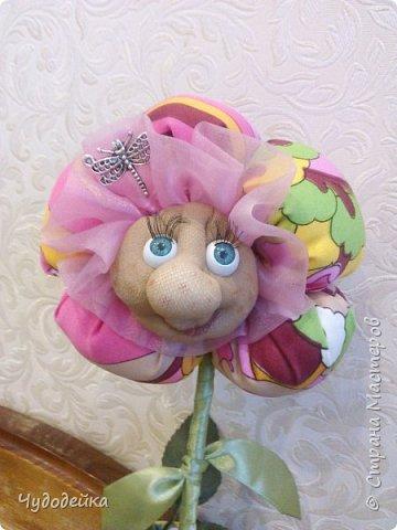Вот такой цветочек у меня получился в этот раз, делала уже подобный, но без личика. МК цветка http://stranamasterov.ru/node/517075?c=favorite фото 5