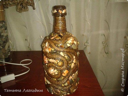 В оформлении  бутылок   были использованы джут,  галька, декоративные камни,ракушки,крупа.  Пробку делала из соленого теста. фото 6
