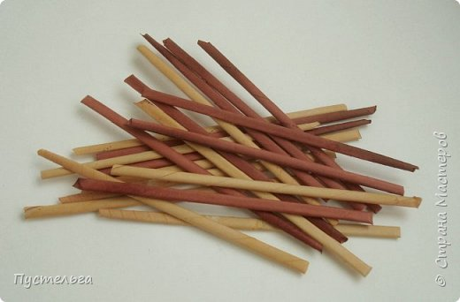Вариант простой поделки к Пасхе из газетных трубочек. фото 8