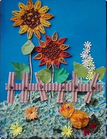 Солнышки на шпажках украшают цветочные горшки. фото 4