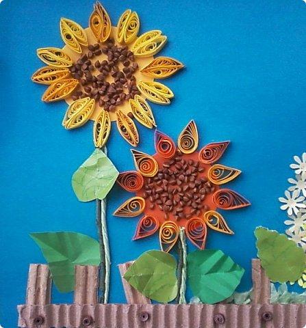 Солнышки на шпажках украшают цветочные горшки. фото 5