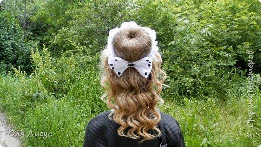 Причёска с украшением на гульку-пучок фото 1