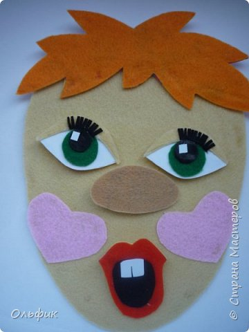 Вот такой клоун получился! Идея проста - ребенок меняет части лица, получается совсем другой человечек! фото 2