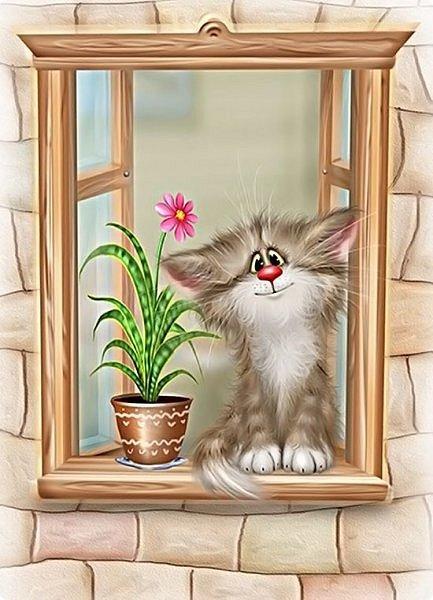 Вот такой котенок поселился у меня на окне. фото 2