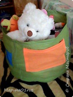 Просматривая и сортируя детские игрушки я наткнулась на старую палатку, выкинуть ее было жалко, поэтому и пришла идея сшить из нее мешок для хранения игрушек.  Нашла Мк в интернете http://www.diy.ru/post/8232/ и вот что получилось. фото 1