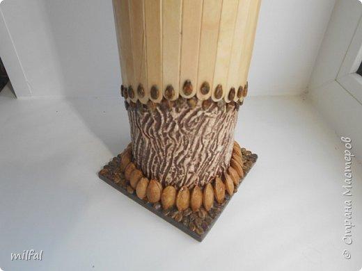 Ваза в стиле этно из бросового материала. Использовала картонную трубу,палочки для мороженного,арбузные и сливовые косточки,шпаклёвку ,клей,лак. фото 7