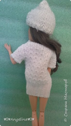 Привет! У меня появилось немного новых кукольных вещей. Одна из них -- это платье. Его шила мама ищ уже вязаной ткани. Я отредактировала фото.  фото 3