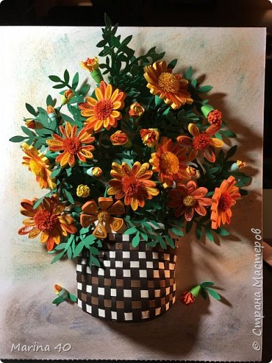 """Good afternoon everyone. This flowers where made a while ago and I just couldn't find the right composition, not until I found MC Крайнова Наталья. I didn't use the muster class but it's gave  me the idea of the composition. Natashenka,thank you very much for sharing your talent . I know that my basket is not perfect and I could of cover it with flowers or leafs, but my moms logic was """" who in the right mind will plant the flowers it the  good  basket , you are doing it only to recycle the old and broken one, so my basket is the recycled one .Marigolds always reminding me of my childhood in Odessa, so every year I am planting them in my garden. фото 1"""