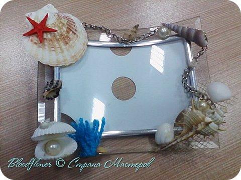 Фоторамка,декорированная искусственными и настоящими ракушками с моря. фото 1