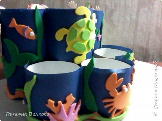 Для изготовления поделки взяла трубочки из под туалетной бумаги и набор на морскую тематику. Так же клей, ножницы и цветная бумага. фото 10