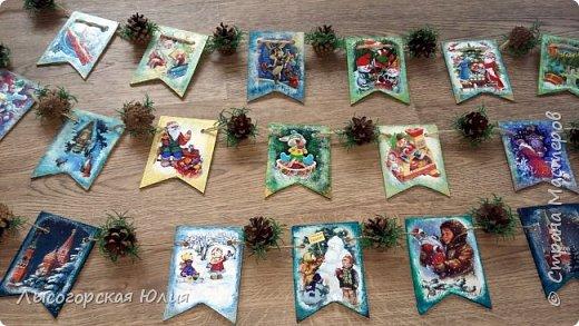Всем здравствуйте! Люблю я рассматривать старые новогодние открытки,( в детстве я их собирала, но к сожалению ничего не сохранила, теперь только в интернете можно увидеть)  и решила сделать из них флажки. Наконец-то закончила свою новогоднюю работу , которую начала еще в феврале.  фото 1