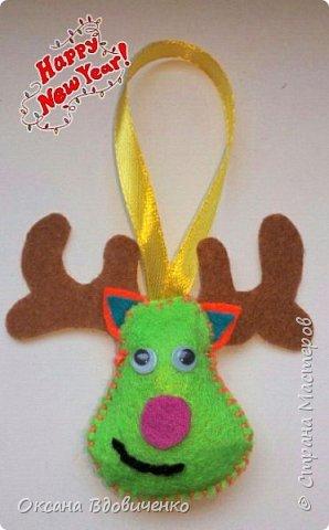 Новогодние игрушки из фетра фото 2