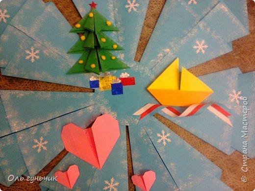 Здравствуйте всем! Попросили меня в школе оформить небольшими плакатами стенд на все времена года...Осень покажу ниже, а это зима...снежинка в технике оригами. Спасибо Голубке за идеи...делала с ребятами ее календарики, а тут решила совместить все зимние месяца и праздники в эти месяцы. Вот что у меня получилось...мне понравилось...все придумала сама, воспользовалась только схемами оригами. фото 11