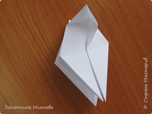 На авторство особо не претендую, возможно такие цветочки уже где-нибудь появлялись, не могу утверждать. Соединительные модули по сборке очень похожи на модуль кусудамы Каркасс Екатерины Лукашевой, только крепление осуществляется по-другому. Короче, такой вот гибрид из двух разных модулей.    Name: Blooming icosahedron - I  Designer: Valentina Minayeva Parts: 12 (pentagons) Paper: 6,4 x 6,4 х 6,4 х 6,4 х 6,4 Parts: 30 (squares) Paper: 6,4 х 6,4 Final height: ~ 10,0 cm without glue фото 18