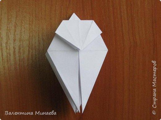 На авторство особо не претендую, возможно такие цветочки уже где-нибудь появлялись, не могу утверждать. Соединительные модули по сборке очень похожи на модуль кусудамы Каркасс Екатерины Лукашевой, только крепление осуществляется по-другому. Короче, такой вот гибрид из двух разных модулей.    Name: Blooming icosahedron - I  Designer: Valentina Minayeva Parts: 12 (pentagons) Paper: 6,4 x 6,4 х 6,4 х 6,4 х 6,4 Parts: 30 (squares) Paper: 6,4 х 6,4 Final height: ~ 10,0 cm without glue фото 20