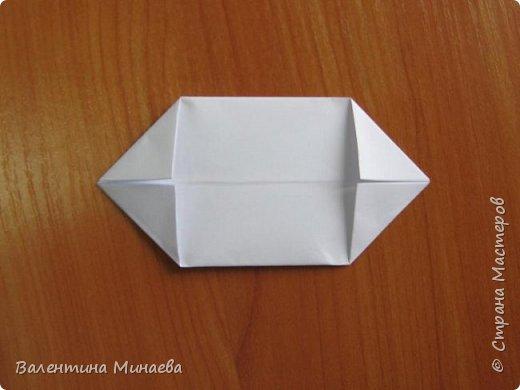 На авторство особо не претендую, возможно такие цветочки уже где-нибудь появлялись, не могу утверждать. Соединительные модули по сборке очень похожи на модуль кусудамы Каркасс Екатерины Лукашевой, только крепление осуществляется по-другому. Короче, такой вот гибрид из двух разных модулей.    Name: Blooming icosahedron - I  Designer: Valentina Minayeva Parts: 12 (pentagons) Paper: 6,4 x 6,4 х 6,4 х 6,4 х 6,4 Parts: 30 (squares) Paper: 6,4 х 6,4 Final height: ~ 10,0 cm without glue фото 38
