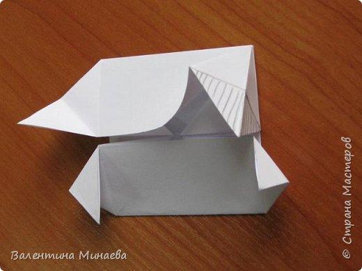 На авторство особо не претендую, возможно такие цветочки уже где-нибудь появлялись, не могу утверждать. Соединительные модули по сборке очень похожи на модуль кусудамы Каркасс Екатерины Лукашевой, только крепление осуществляется по-другому. Короче, такой вот гибрид из двух разных модулей.    Name: Blooming icosahedron - I  Designer: Valentina Minayeva Parts: 12 (pentagons) Paper: 6,4 x 6,4 х 6,4 х 6,4 х 6,4 Parts: 30 (squares) Paper: 6,4 х 6,4 Final height: ~ 10,0 cm without glue фото 45