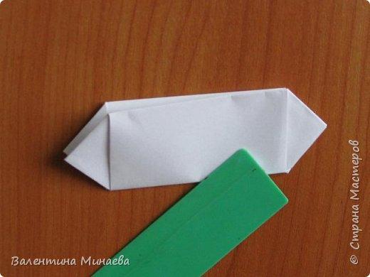 На авторство особо не претендую, возможно такие цветочки уже где-нибудь появлялись, не могу утверждать. Соединительные модули по сборке очень похожи на модуль кусудамы Каркасс Екатерины Лукашевой, только крепление осуществляется по-другому. Короче, такой вот гибрид из двух разных модулей.    Name: Blooming icosahedron - I  Designer: Valentina Minayeva Parts: 12 (pentagons) Paper: 6,4 x 6,4 х 6,4 х 6,4 х 6,4 Parts: 30 (squares) Paper: 6,4 х 6,4 Final height: ~ 10,0 cm without glue фото 50