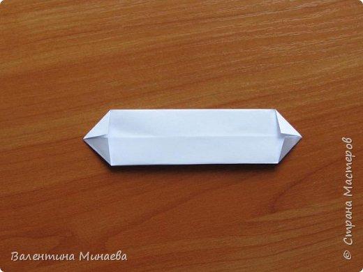 На авторство особо не претендую, возможно такие цветочки уже где-нибудь появлялись, не могу утверждать. Соединительные модули по сборке очень похожи на модуль кусудамы Каркасс Екатерины Лукашевой, только крепление осуществляется по-другому. Короче, такой вот гибрид из двух разных модулей.    Name: Blooming icosahedron - I  Designer: Valentina Minayeva Parts: 12 (pentagons) Paper: 6,4 x 6,4 х 6,4 х 6,4 х 6,4 Parts: 30 (squares) Paper: 6,4 х 6,4 Final height: ~ 10,0 cm without glue фото 68