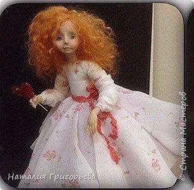 кукла с конфеткой