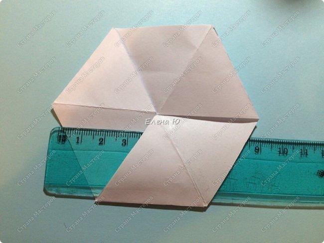 Предлагаю сделать забавную и совсем несложную  безделушку (головоломку)  - флексагон. Флексагоны — плоские модели из полосок бумаги, способные складываться и сгибаться определённым образом.  фото 16