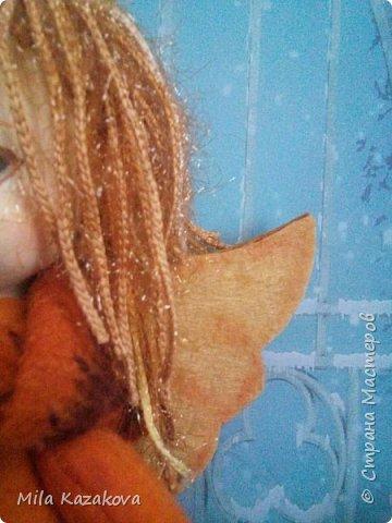 Озорной и романтичный ангелочек, сшит из фетра. Личико из моделирующей массы Darwi классический. Волосы из пряжи с блеском. . Лицо отшлифовано, загрунтовано ,покрашено акриловой краской телесного цвета, покрыто лаком. Тело на каркасе. Лицо расписано акриловыми красками и пастелью. Интерьерная игрушка. Высота 20см. Сердечко из пенопласта. Покрашено акриловой краской. Сделан декупаж. Приятного просмотра! фото 5